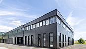 Construction d'un bâtiment comprenant surfaces industrielles et commerciales entièrement modulables à Bevaix