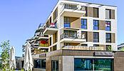 Construction d'un bâtiment de logements et surfaces commerciales La Toula à Bulle pour La Mobilière